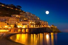 Night view of Amalfi on coast line of mediterranean sea, Italy. Night view of Amalfi cityscape on coast line of mediterranean sea, Italy Royalty Free Stock Photos