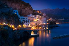 Night view of Amalfi on coast line of mediterranean sea, Italy royalty free stock photo