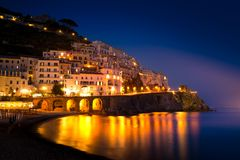 Night view of Amalfi on coast line of mediterranean sea, Italy. Night view of Amalfi cityscape on coast line of mediterranean sea, Italy Stock Photo