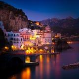 Night view of Amalfi on coast line of mediterranean sea, Italy. Night view of Amalfi cityscape on coast line of mediterranean sea, Italy royalty free stock image