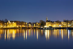 Night view of Amsterdam with lights reflecting in the water Royalty Free Stock Image
