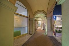 Night view of ancient arcade. Ancient arcade of medieval town shops in Romagna, Italy Royalty Free Stock Photography
