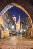 Gdansk, Poland, night view through gothic archway onto Mariacka street stock image
