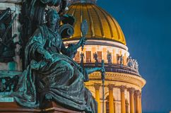 Night view of the ancient statues of stucco and the dome of St. Isaac`s Cathedral Saint-Petersburg. Stock Photography