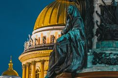 Night view of the ancient statues of stucco and the dome of St. Isaac`s Cathedral Saint-Petersburg. Stock Photo