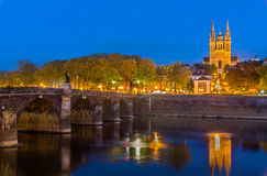 Night view of Angers with Verdun Bridge and Saint Maurice Cathedral - France Stock Photography