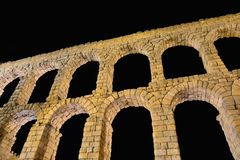 Night view of aqueduct of Segovia, Spain. Royalty Free Stock Photos