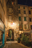 Night view of arch and square with buildings and light of lanterns in Draguignan. Draguignan, France - July 10, 2016. Night view of arch and square with Royalty Free Stock Photography
