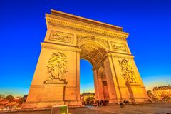 Arc de Triomphe blue hour. Night view of Arch of Triumph at the center of the Place Charles de Gaulle. Bottom view of popular landmark at blue hour and famous Royalty Free Stock Image