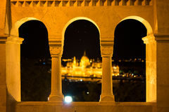 Night view Arch window of Danube River and Parliament Building, Budapest, Hungary. The building of the Hungarian Parliament in Budapest at the river Danube Stock Photo