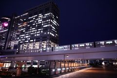 Night View around Daiba. Office of the company Fuji Television on Odaiba. Moving train in Tokyo stock images
