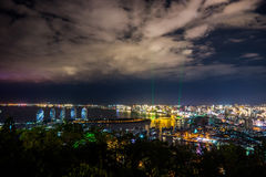 Night view of an artificial Phoenix island and Sanya city stock image