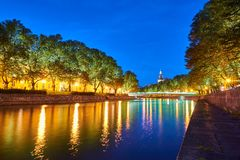 The night view of Aura river in Turku, Finland. The night view of Aura river in Turku, Finland with a clock tower of cathedral and bridge on a background stock image