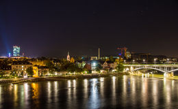 Night view of Basel over Rhine, Switzerland Royalty Free Stock Images