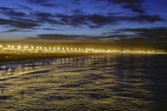 Night view of the beach of Valencia. Night view of a Mediterranean beach with illuminated promenade stock image