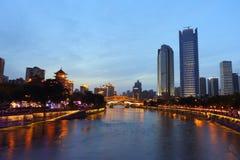 Night view of beautiful Anshun Bridge above Jinjiang river, and downtown of Jiuyanqiao in the blue hour Royalty Free Stock Photos