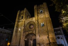 Sé Cathedral at night in Lisbon. Night view of the beautiful medieval facade of Cathedral of Saint Mary Major in Lisbon, built in the 12th century Stock Photos