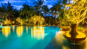 Night view of beautiful swimming pool in resort , Phuket, Thailand Royalty Free Stock Images