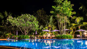 Night view of beautiful swimming pool in tropical resort Royalty Free Stock Photos