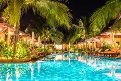 Night view of beautiful swimming pool in tropical resort , Phuke. Night view of beautiful swimming pool in tropical resort Phuket Thailand Royalty Free Stock Photo