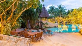 Night view of beautiful swimming pool in tropical resort , Phuket Stock Photo