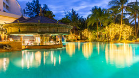 Night view of beautiful swimming pool in tropical resort , Phuket, Thailand. Night view of beautiful swimming pool in tropical resort on Phuket, Thailand Royalty Free Stock Photo