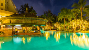 Night view of beautiful swimming pool in tropical resort , Phuket, Thailand. Night view of beautiful swimming pool in tropical resort , Phuket in Thailand Stock Images