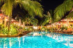 Night view of beautiful swimming pool in tropical resort Royalty Free Stock Image