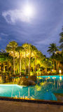 Night view of beautiful swimming pool in tropical resort , Thailand Stock Photography