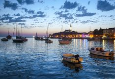 Night view of beautiful town Rovinj in Istria, Croatia. Evening in old Croatian city, night scene with water reflections stock image