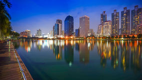 Night View of benjakiti park Bangkok Thailand. near the skyscraper business district,Bangkok city. Benchakitti Park near the skyscraper business district,Bangkok Stock Photo