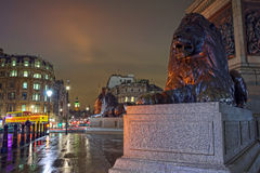 Night view on Big Ben from Trafalgar square. View along the Whitehall street, from the lion sculptures at Trafalgar square towards Big Ben, London Royalty Free Stock Images