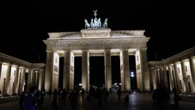 Night view of the Brandenburg Gate in Berlin, people are walking in the square, Germany at night, Berlin. Night view of the Brandenburg Gate in Berlin, people stock video