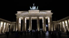 Night view of the Brandenburg Gate in Berlin, people are walking in the square, Germany at night, Berlin. Night view of the Brandenburg Gate in Berlin, people stock footage