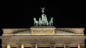 Night view of the Brandenburg Gate in Berlin, people are walking in the square, Germany at night, Berlin. Night view of the Brandenburg Gate in Berlin, people stock video footage