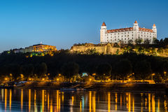 Night view of Bratislava castle in capital city of Slovak republic. With reflections of night lights in the water. Travel photography Royalty Free Stock Images