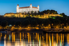 Night view of Bratislava castle in capital city of Slovak republic. With reflections of night lights in the water. Travel photography Royalty Free Stock Photos
