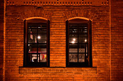 Night view of brick wall Stock Images