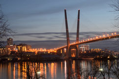 Night view for the bridge across the Golden horn bay in Vladivostok Royalty Free Stock Images
