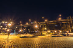 Night view of the bridge and parking near the entrance to the park Dynamo. Voronezh city Royalty Free Stock Photo