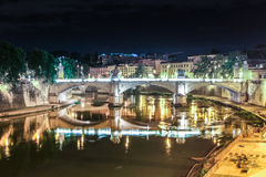 Night view of the bridge under Tiber river in Rome, Italy. Panaoramic view  of the bridge under Tiber river in  night, Rome, Italy Royalty Free Stock Image