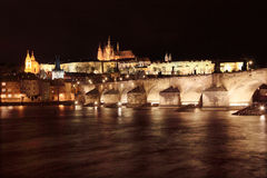 The night View on bright Prague ONight Prague gothic Castle with Charles Bridge Royalty Free Stock Photos