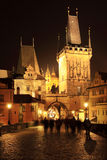 The night View on bright Prague St. Nicholas' Cathedral above the River Vltava, Czech Republic Stock Image