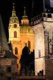The night View on bright Prague St. Nicholas' Cathedral above the River Vltava Royalty Free Stock Images