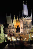 The night View on bright Prague St. Nicholas' Cathedral above the River Vltava Stock Images