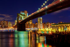 Night view of Brooklyn bridge and Skyscrapers in New York Royalty Free Stock Images