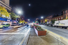 Night view in Brooklyn of main street with headlights of cars Stock Images