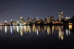 Night view of buildings by the lake Stock Image