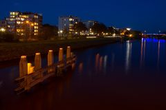 Night view of buildings located on the canal in Hoogeveen Royalty Free Stock Image