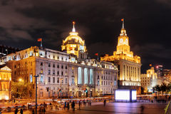 Night view of the Bund Waitan in Shanghai, China. The Shanghai Custom House building with clock tower is visible at right, the HSBC Building the Municipal Royalty Free Stock Image